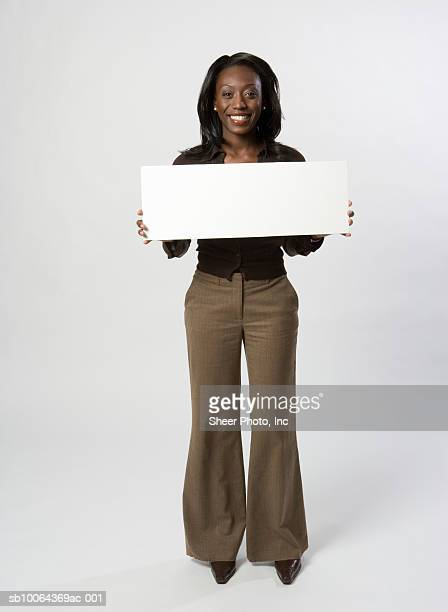 Portrait of young business woman with blank sign