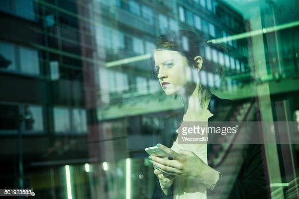 Portrait of young business woman with smartphone