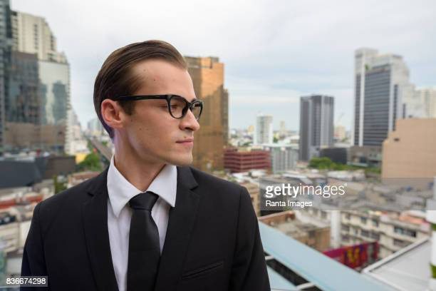Portrait of young businessman enjoying life in the city of Bangkok Thailand