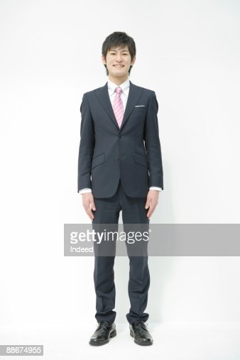 Portrait of young businessman, full length