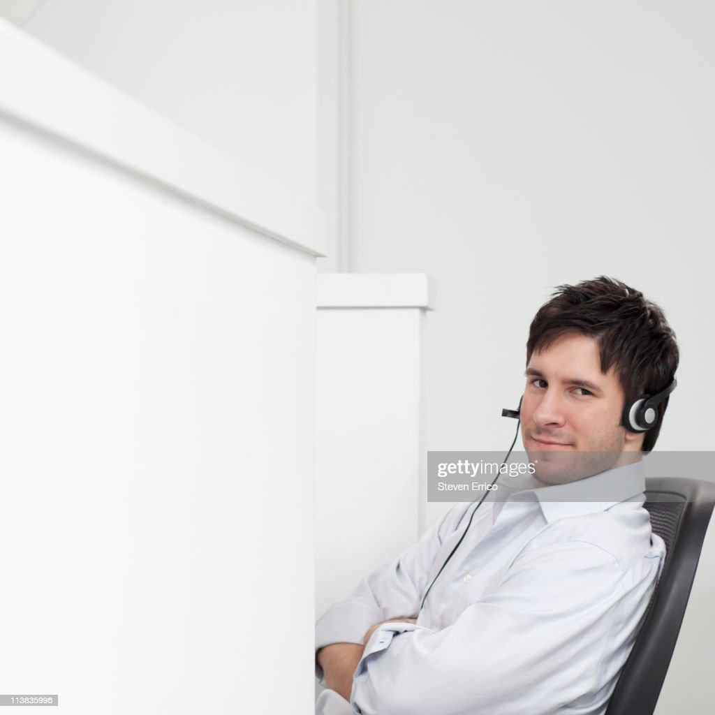 Portrait of young businessman wearing headset