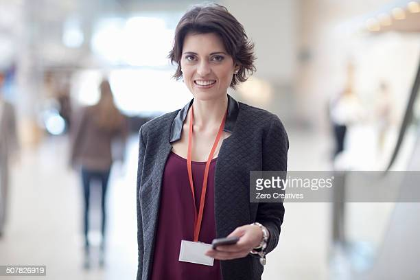 Portrait of young businesswoman in conference centre