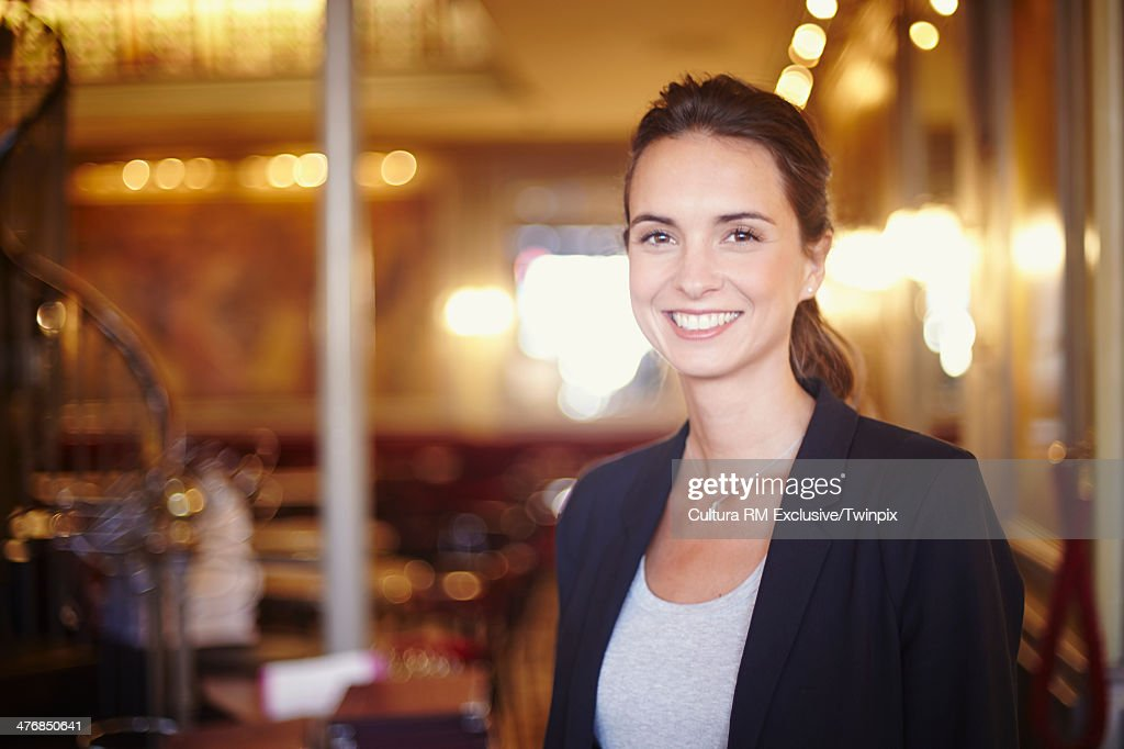 Portrait of young businesswoman in restaurant