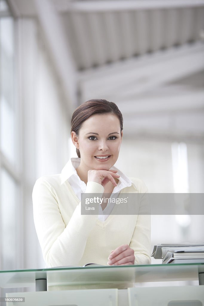 portrait of young businesswoman sitting at desk : Stock Photo