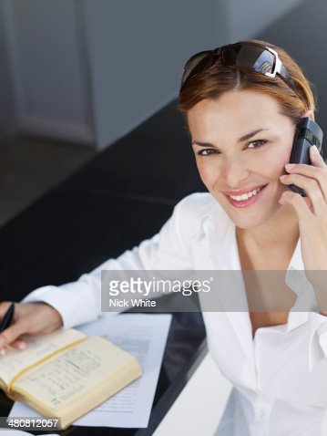 Portrait of young businesswoman using mobile phone : Stock Photo