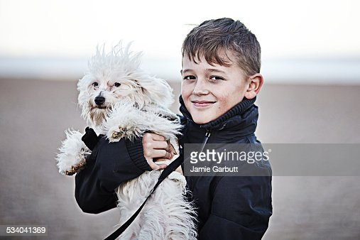 Portrait of young child male with dog