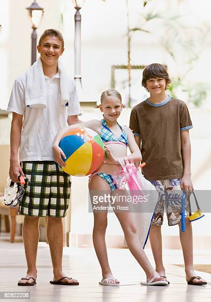 Portrait of young children walking to the pool