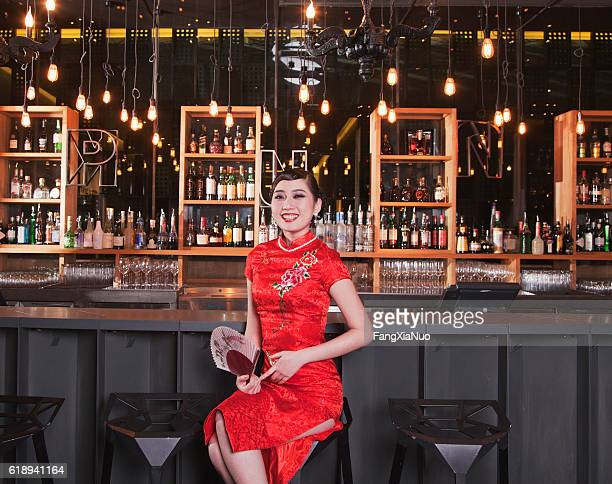 Portrait of young Chinese woman in traditional qipao dress