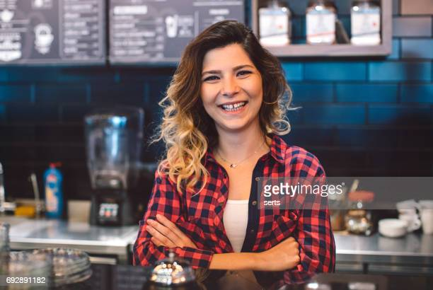 Portrait of young coffee shop business owner woman