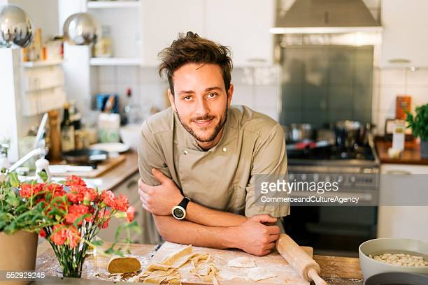 Portrait of young cook in kitchen