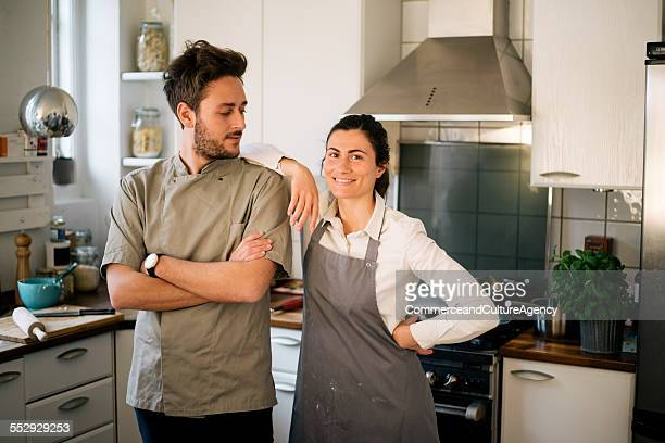Portrait of young cooks in kitchen