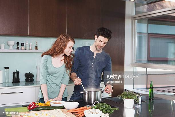Portrait of young couple cooking together
