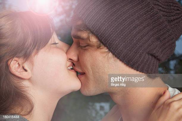 Portrait of young couple, kissing