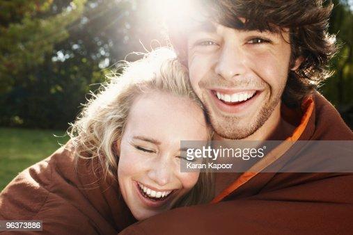 Portrait of young couple laughing : Bildbanksbilder
