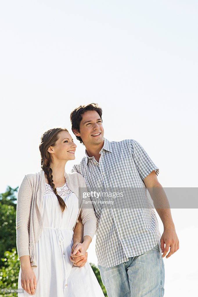 Portrait of young couple looking at view outdoors : Stock Photo