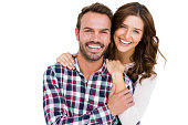 Portrait of young couple smiling on white background
