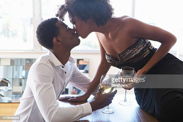 Portrait of young couple with wine, kissing