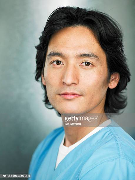 Portrait of young doctor in scrubs