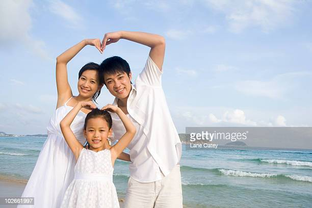 Portrait of young family at the beach