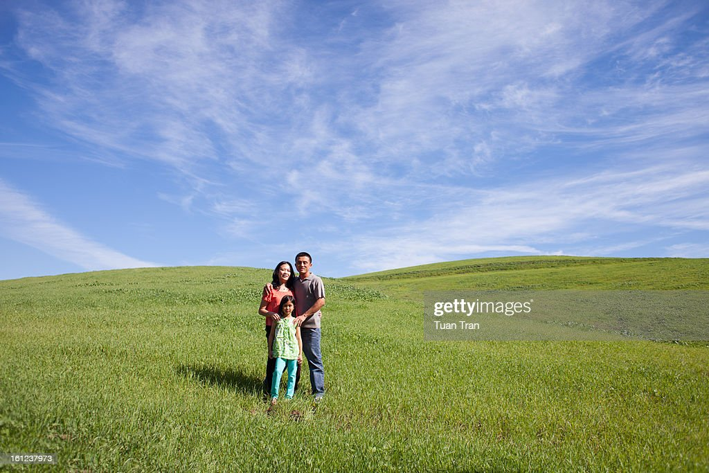 Portrait of young family at the park : Stock Photo