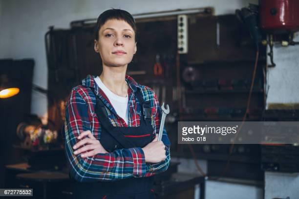 Portrait of young female mechanic