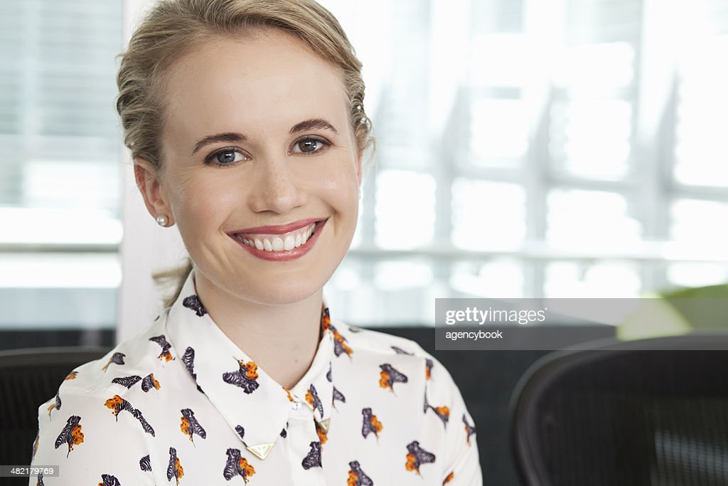 Portrait of young female office worker : Stock Photo