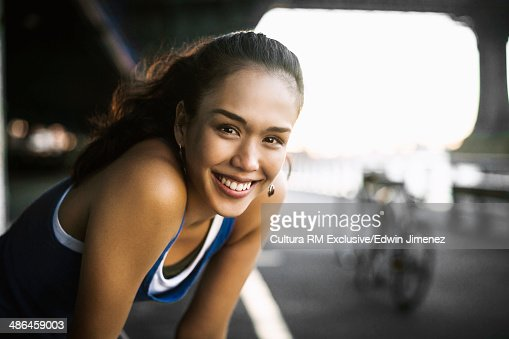 Portrait of young female runner taking a break, New York City, USA