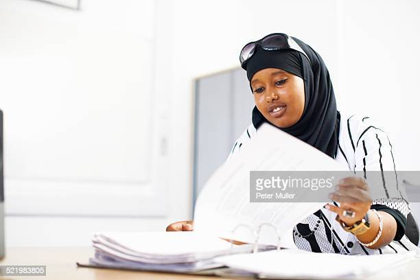Portrait of young female student in college classroom