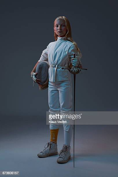 Portrait of young fencer looking to camera