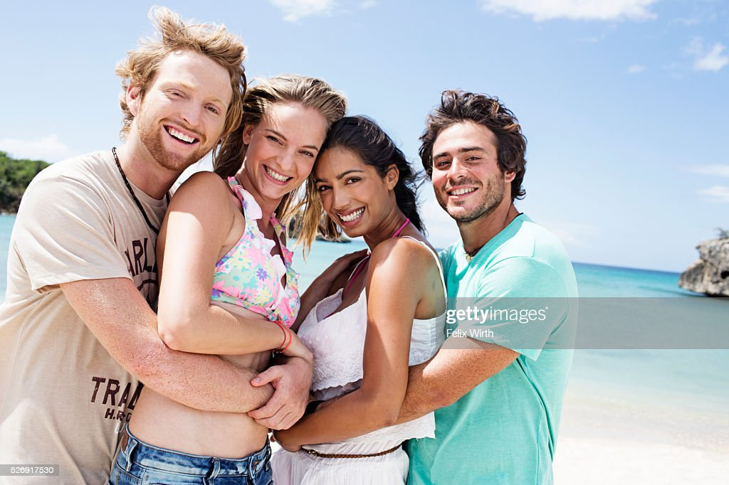 Portrait of young friends on beach : Stock Photo
