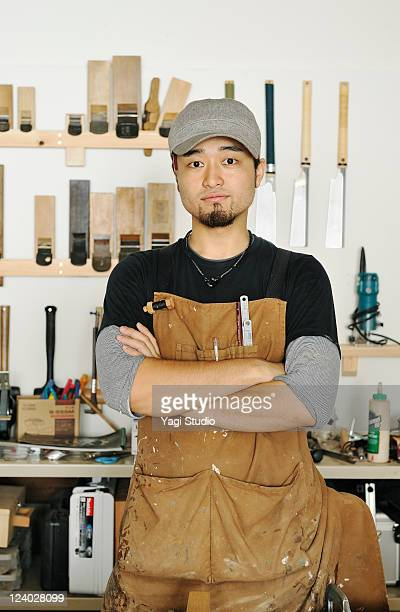 Portrait of young furniture craftsman