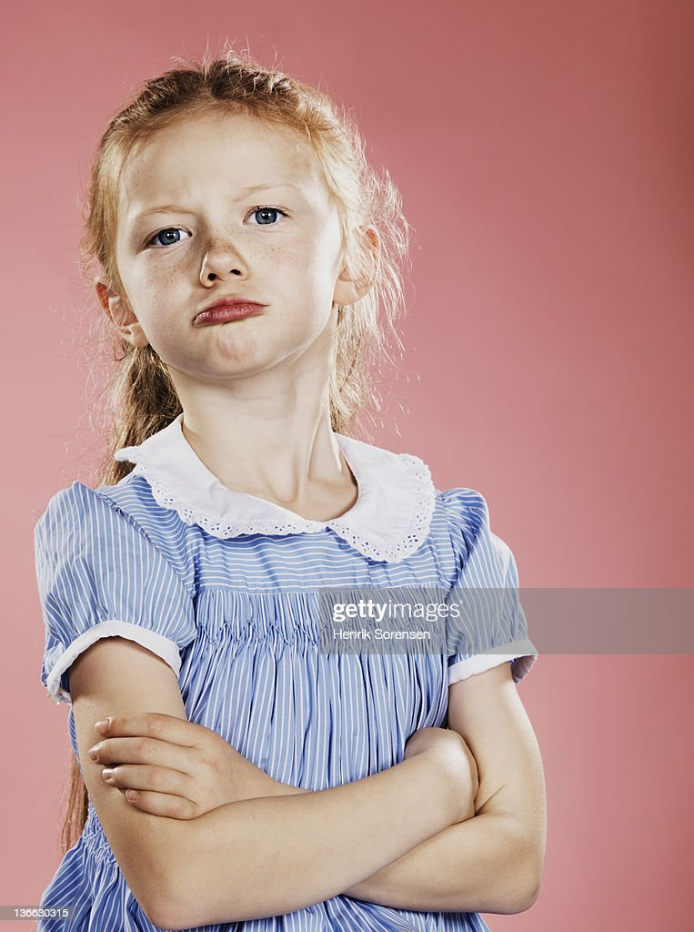 Portrait of young girl, arms crossed,