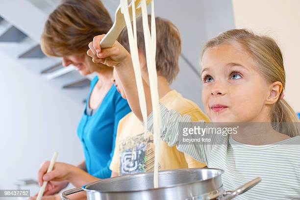 portrait of young girl cooking pasta