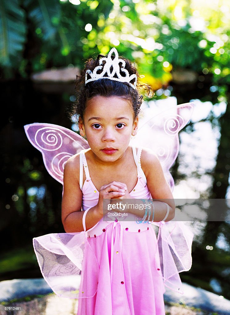 Portrait of young girl (7-8) dressed as an angel : Stock Photo