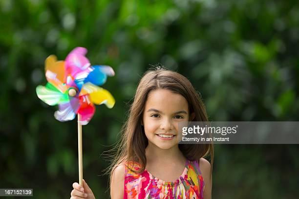 Portrait of young girl holding pinwheel