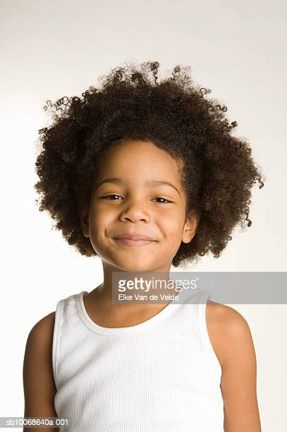 Portrait of young girl (4-5) in tank top, smiling