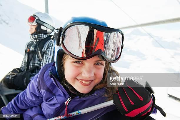 Portrait of young girl on ski lift, Les Arcs, Haute-Savoie, France