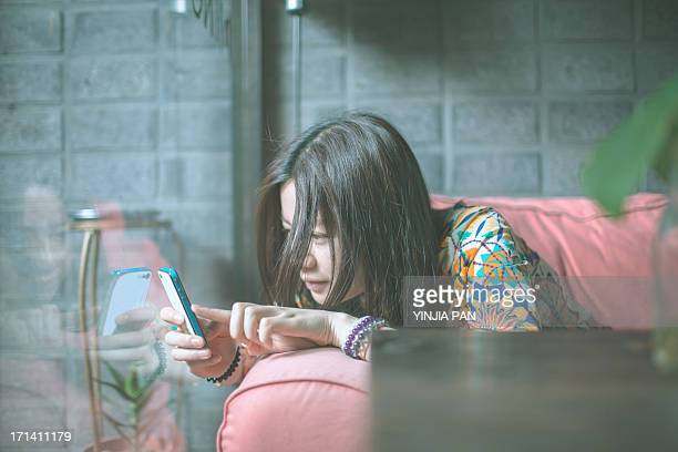 Portrait of young girl taking pictures in cafe
