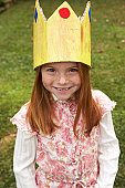 Portrait of young girl (6-7) wearing paper crown
