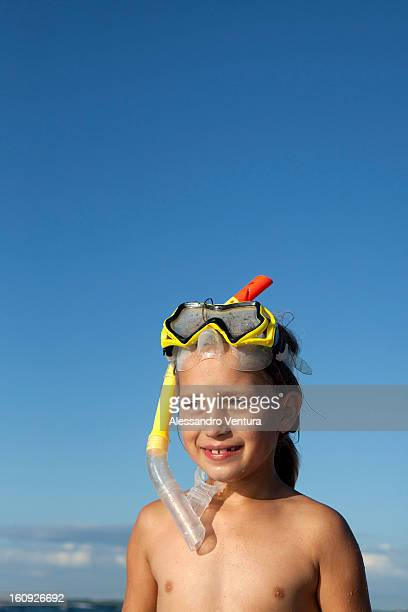 portrait of young girl with diving goggles