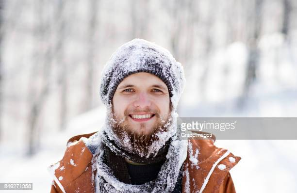 Portrait of young hipster outside in winter.