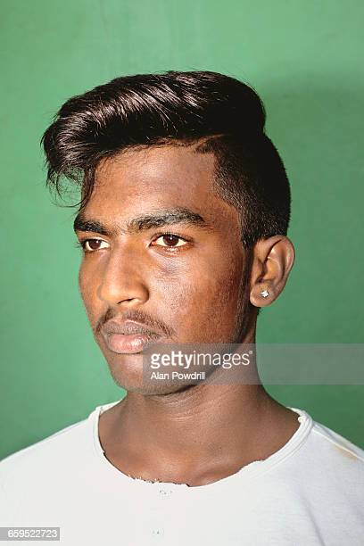 Portrait of young Indian man with pompadour hair