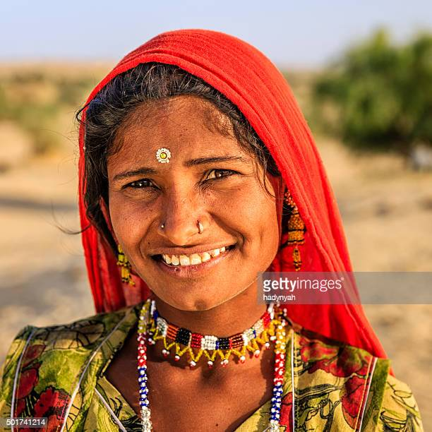 Portrait of young Indian woman, desert village, Rajasthan, India.