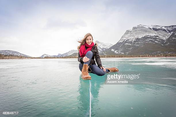 Portrait of young lady sitting on frozen pond, mtn