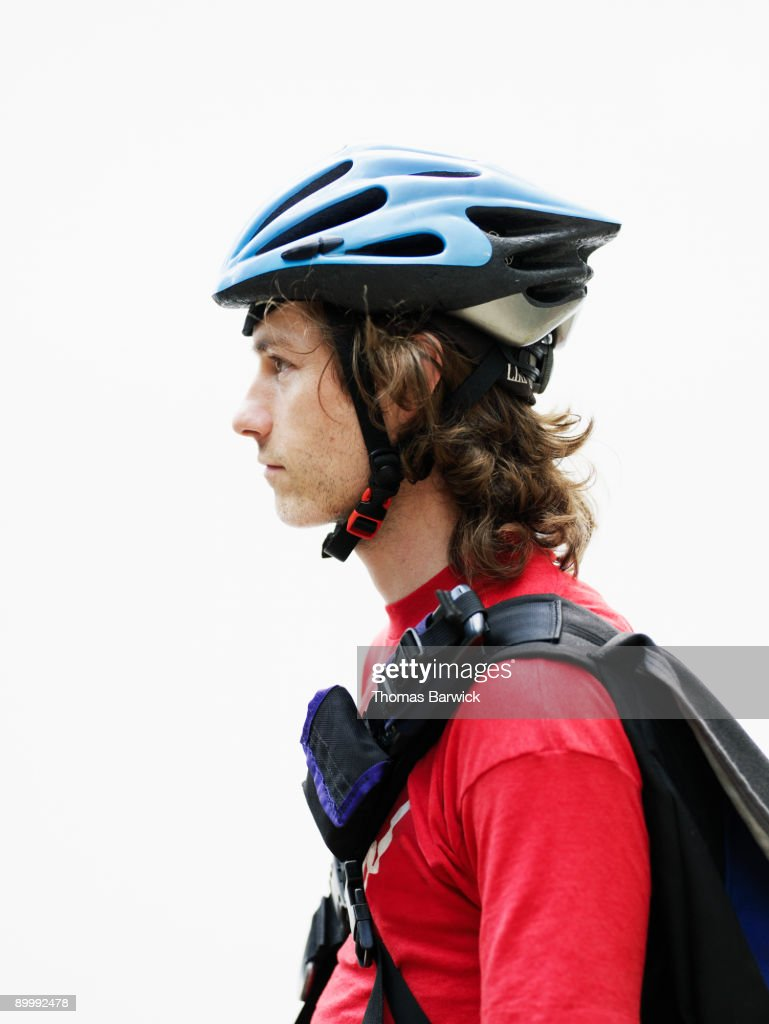 Portrait of young male bicycle messenger : Stock Photo