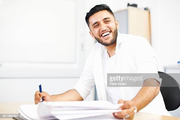 Portrait of young male student in college classroom