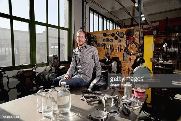 Portrait of young male vodka distiller in distillery workshop
