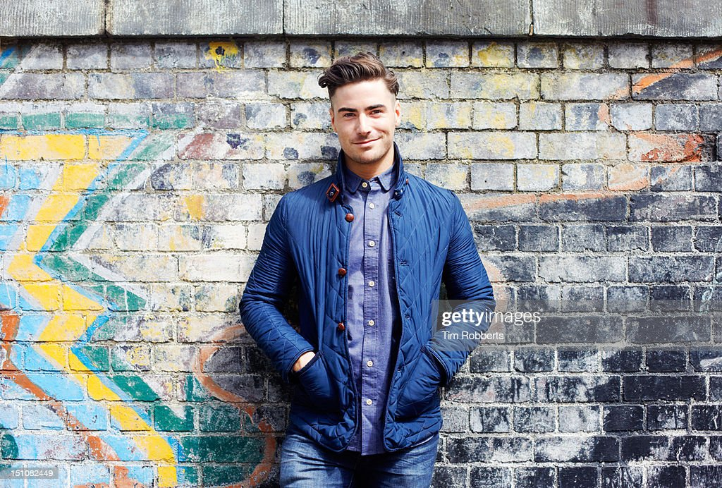 Portrait of young man against wall. : Stock Photo