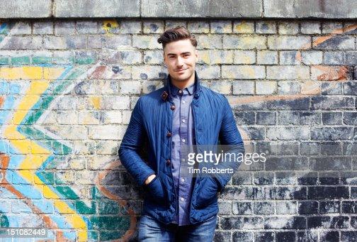 Portrait of young man against wall. : Foto de stock