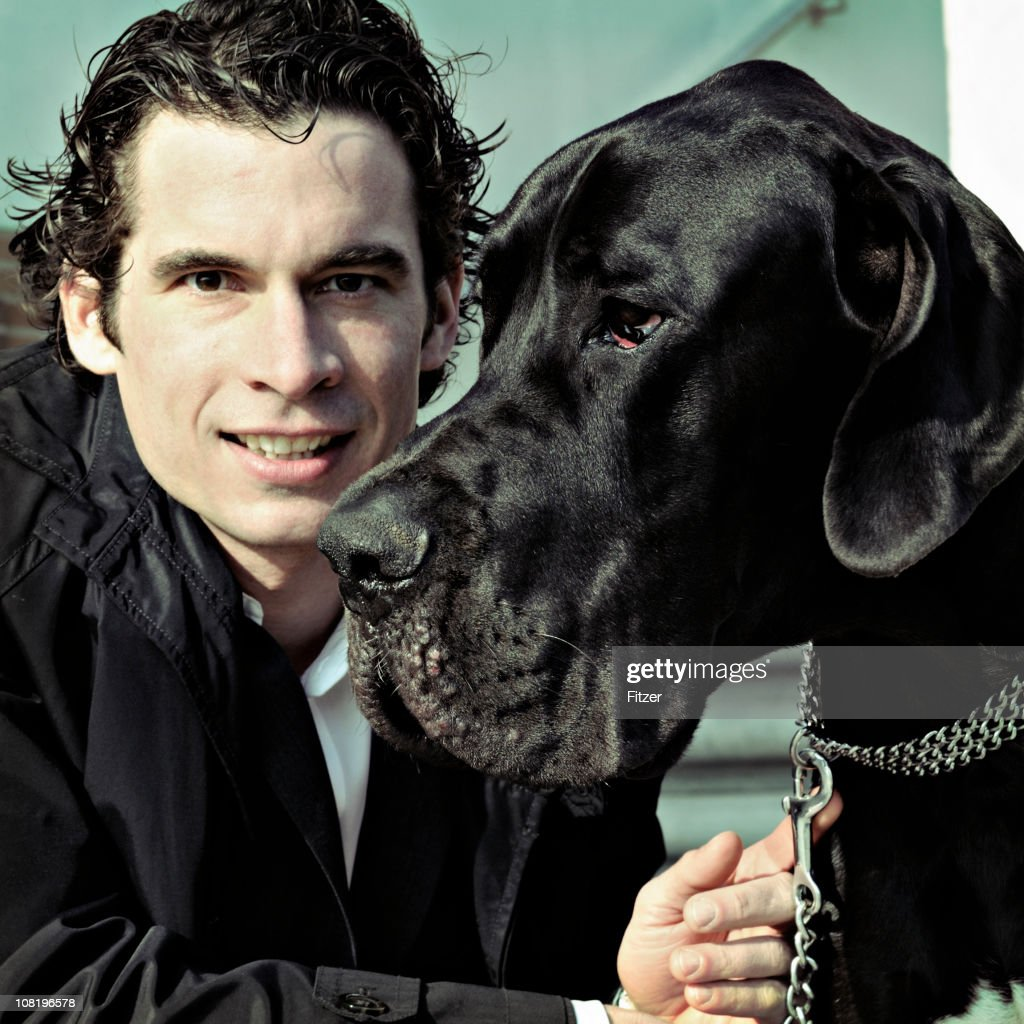 Portrait of Young Man and Mastiff Dog : Stock Photo